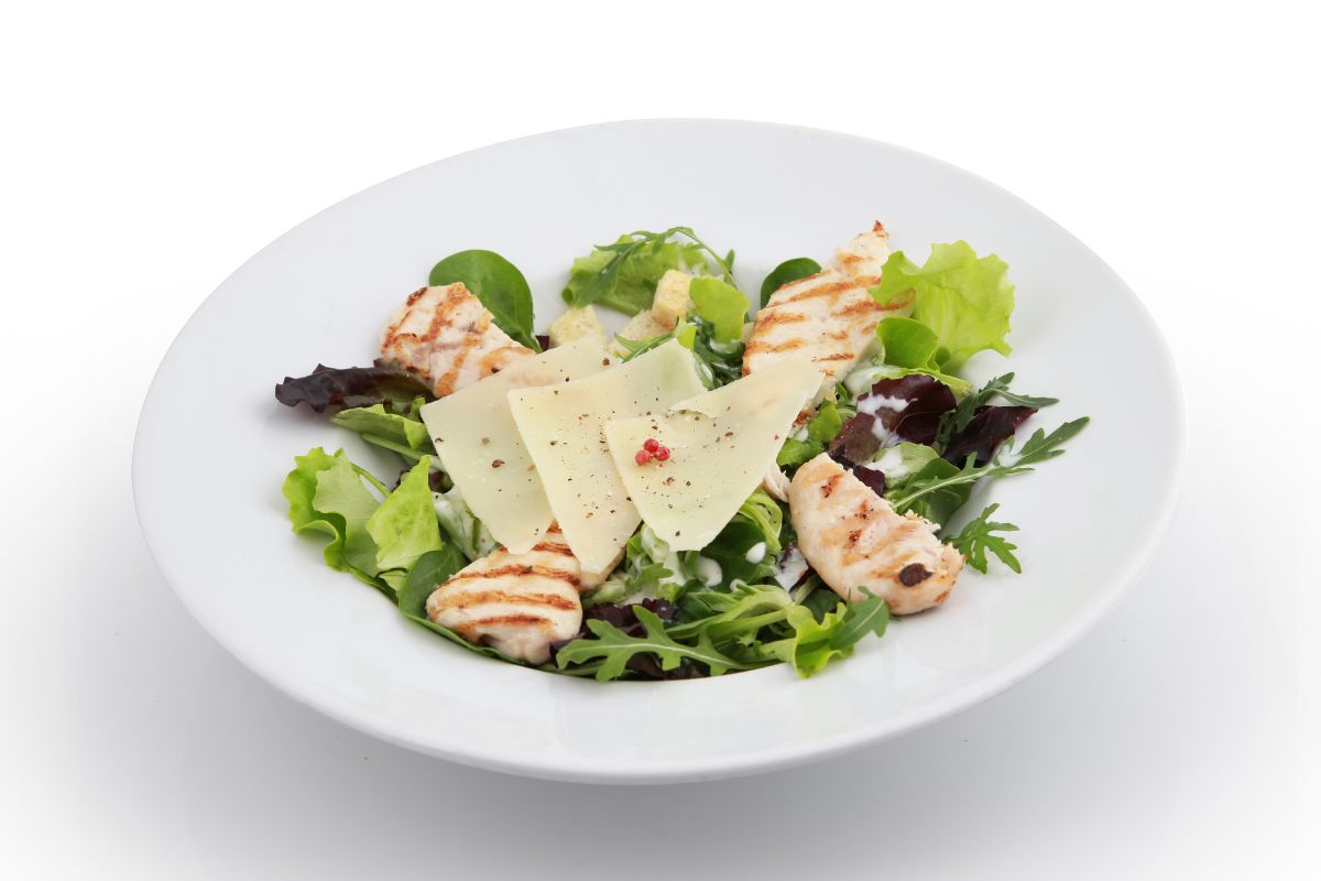 Romain salad, grilled chicken breast, anchovies, parmesan, garlic croutons, Caesar dressing